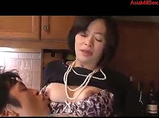 Asian milf loves getting her pussy licked in the kitchen