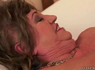 Busty fat grandma enjoys nasty sex with a young boy