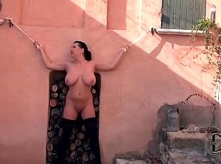 Busty bound girl takes a piss outdoors