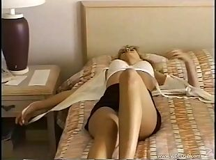 A sexy blonde wakes from a nap, takes off her thong and rubs her pussy