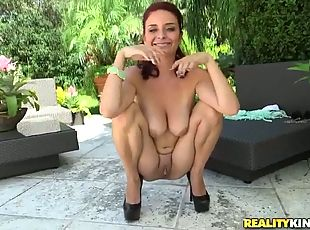 Red haired chick gets her puffy pussy finger fucked outdoor