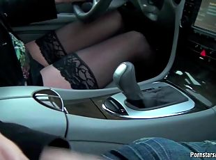 She reaches over an gives a handjob while they drive down the street