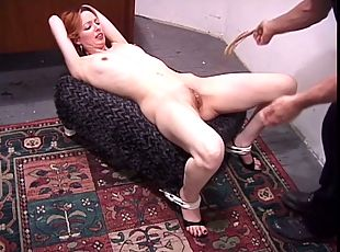 Cute redhead bound with her legs spread for her masters pleasure