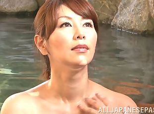 Erotic mature Japanese woman takes a man's cum in her mouth