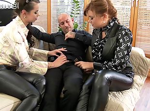 Leather-clad cougar with a hot ass enjoying a hardcore threesome