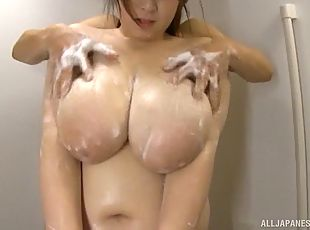 Big-boobed Japanese lass gives the partner a titjob in the bathroom