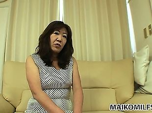 Asian granny shows she still has a few tricks up her cunt and strips