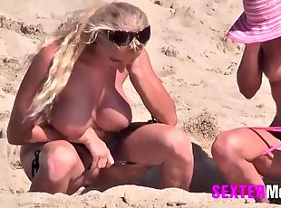Four sexy ladies get naked and play on the beach