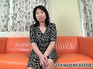 Chubby Asian wife undresses and spreads her legs for action in the couch